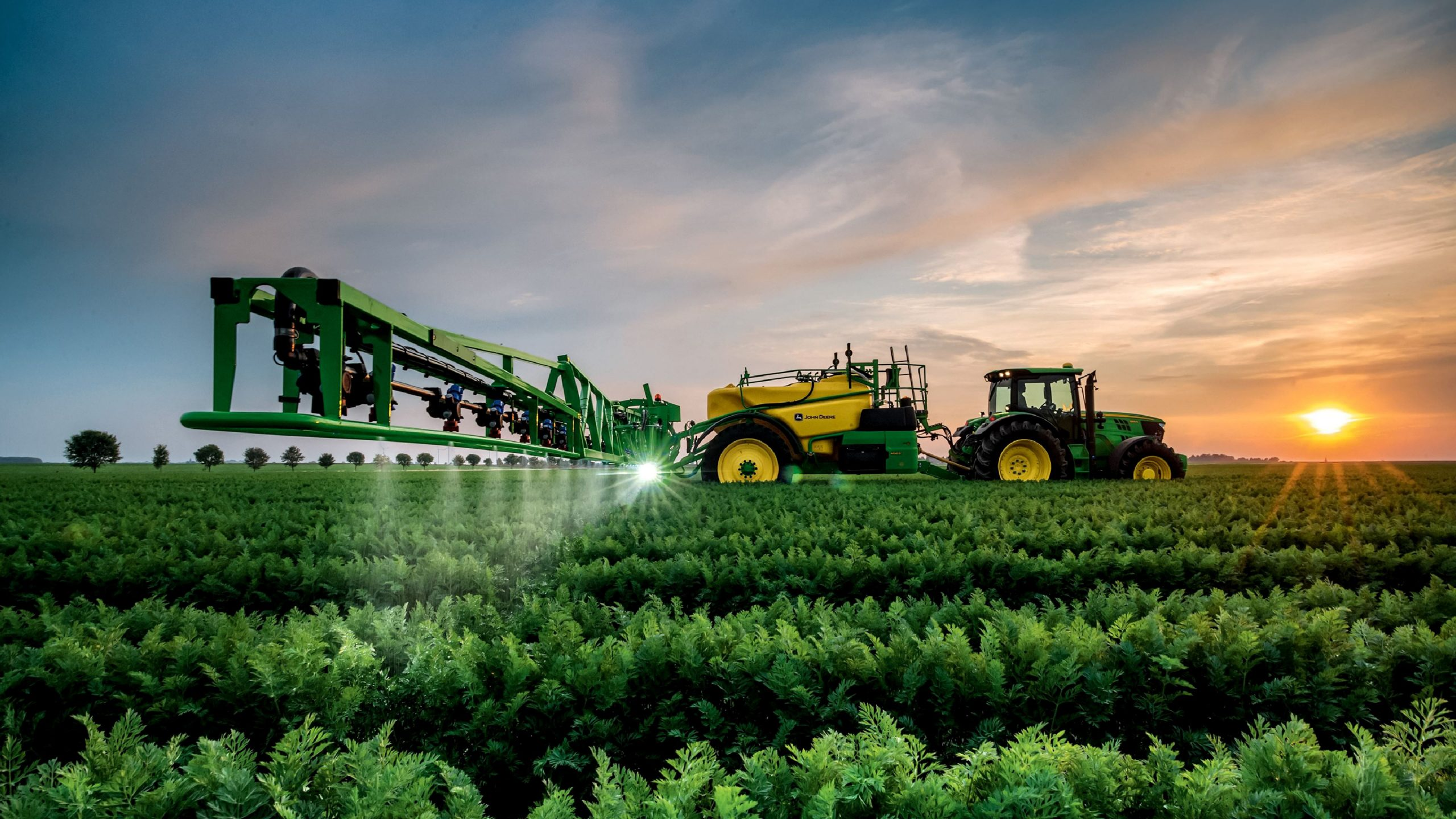 John Deere Tractor and Sprayer with Sunset